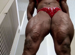 Dark-hued damsel bodybuilder in..